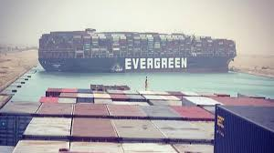Suez Canal blocked by a large container ship causing traffic jam for cargo vessels